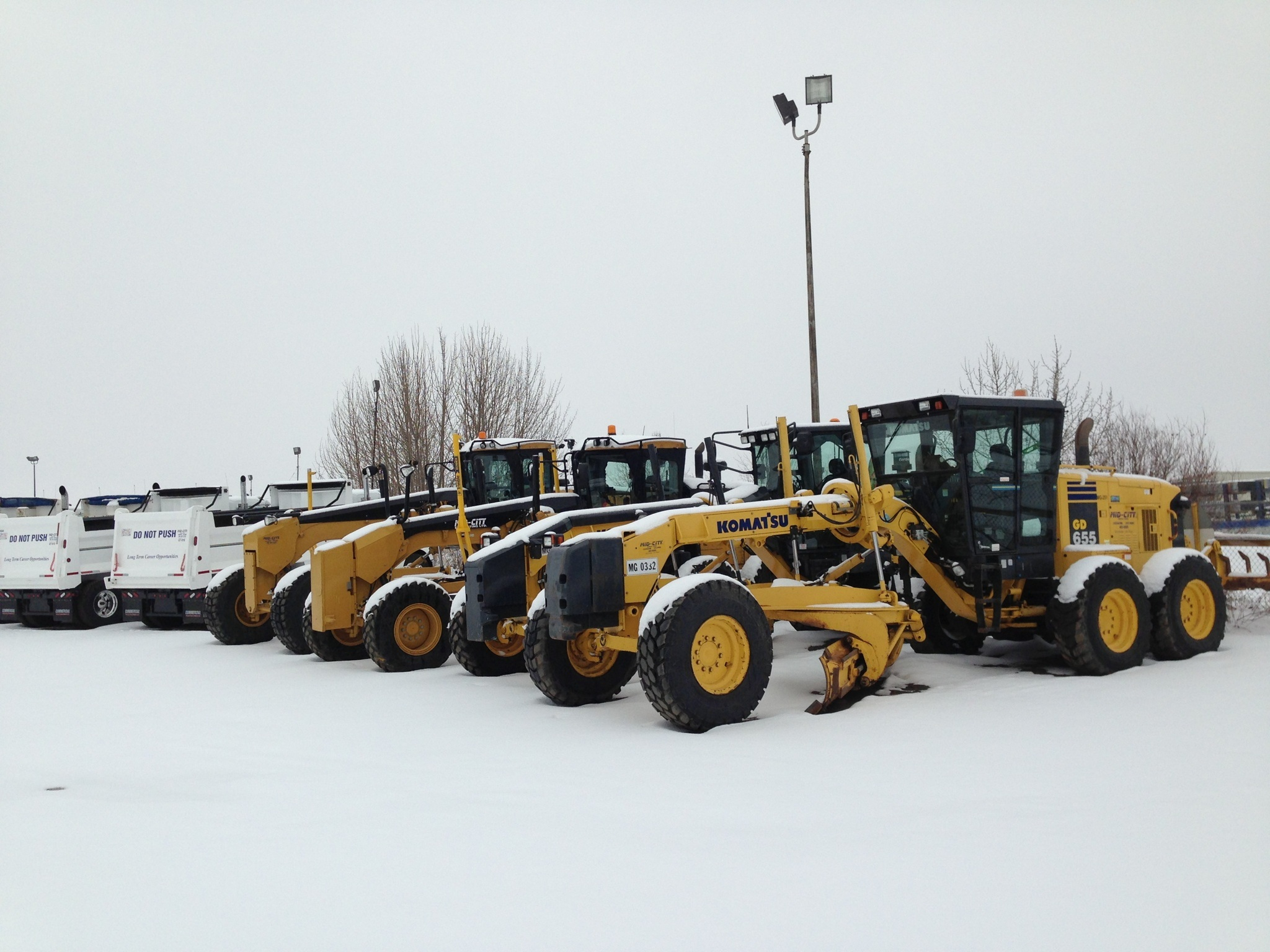 Graders Snow Removal - Mid-City Construction Management